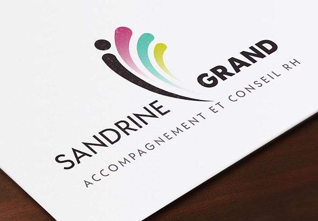Logo Sandrine Grand - Création de logos par Emilie Le Béhérec Prima, graphiste freelance dans le Finistère